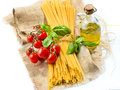 Pasta spaghetti vegetables spices oil and Royalty Free Stock Photo