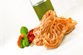 Pasta tagliatelle isolated with oil tomato and bell peppers Stock Photo