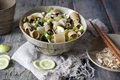 Pasta thai with lemon, almond, olive sliced and green pepperoni on bowl Royalty Free Stock Photo