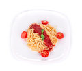 Pasta with tomato sauce and basil on a white background Stock Images