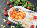 Pasta with tomato sauce, zucchini, parsley and sausages Royalty Free Stock Photo