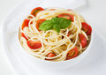 Pasta with tomatoes and basil Stock Photography