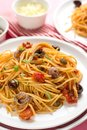 Pasta with tomatoes, olives, capers and anchovies Spaghetti alla Royalty Free Stock Photo