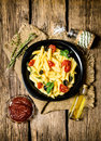 Pasta with tomatoes, olives and herbs. Royalty Free Stock Photo