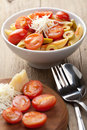 Pasta with tomatoes and salami Stock Photo