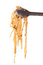 Pasta with tongs isolated linguine metal on white background Stock Photography