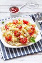 Pasta traditional italian with cherry tomatoes basil and parmesan Stock Photo