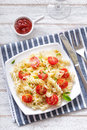 Pasta traditional italian with cherry tomatoes basil and parmesan Royalty Free Stock Photography