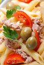 Pasta tuna olives tomato white plate Royalty Free Stock Photos