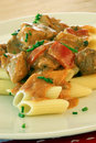 Pasta with turkey goulash on a plate Stock Photography