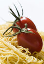 Pasta and two tomatoes Royalty Free Stock Photo