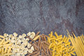Pasta varieties over slate food background Royalty Free Stock Image