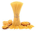 Pasta varieties of spaghetti tied in a bundle tagliatelle penne macaroni fusilli rigatoni and fiorelli over white background Stock Photos