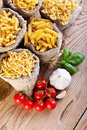 Pasta variety and specific cooking ingredients in small bags top view Stock Images