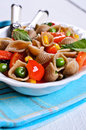 Pasta with vegetables in the shape of seashells from rye flour Stock Photo