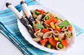 Pasta with vegetables in the shape of seashells from rye flour Royalty Free Stock Image