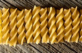 Pasta on the wooden background spiral Stock Photo
