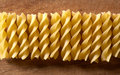 Pasta on the wooden background spiral Stock Image