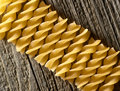 Pasta on the wooden background spiral Royalty Free Stock Image