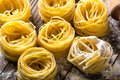 Pasta on wooden table Royalty Free Stock Images