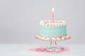Pastel Blue Birthday Cake over White Background. Royalty Free Stock Photo