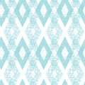 Pastel blue fabric ikat diamond seamless pattern vector background with hand drawn elements Royalty Free Stock Image