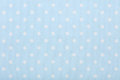Pastel blue polka dot fabric macro, texture background Royalty Free Stock Photo