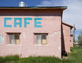 Pastel cafe retro building with hand painted sign in a small town in the southwest united states Royalty Free Stock Photo