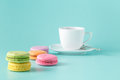 Pastel color macaroon with coffee on aquamarine background Royalty Free Stock Photo