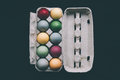 Pastel colored easter eggs in a box unusual on black Royalty Free Stock Images