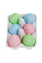 Pastel colored easter eggs in cardboard isolated Stock Photo