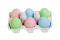 Pastel colored easter eggs in cardboard isolated on white Stock Photography
