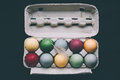 Pastel colored easter eggs with feather unusual in a box on black Stock Photo