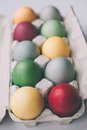 Pastel colored easter eggs unusual in a box Stock Images