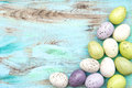 Pastel colored easter eggs on wooden background nostalgic retro style picture Royalty Free Stock Image