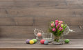 Pastel colored tulip flowers and easter eggs over wooden background Royalty Free Stock Photos