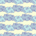Pastel colored vector hand drawn clouds seamless pattern