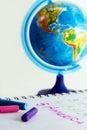 Pastel crayons and globe. Royalty Free Stock Image
