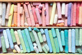 Pastel crayons in wooden artist box closeup. Royalty Free Stock Photo