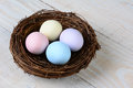 Pastel easter eggs high angle shot of a birds nest with eeaster horizontal format Stock Photo