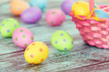 Pastel easter eggs on vintage green colored wooden background Royalty Free Stock Images