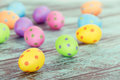 Pastel easter eggs on vintage green colored wooden background shallow depth of field Royalty Free Stock Photo