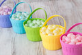 Pastel easter jelly beans in colorful baskets colored brightly colored a row Royalty Free Stock Photo