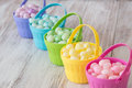 Pastel easter jelly beans in colorful baskets colored brightly colored a row Royalty Free Stock Image