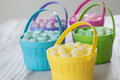Pastel jelly beans in colored baskets for easter brightly Royalty Free Stock Photos