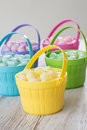 Pastel jelly beans in colored baskets for easter brightly Stock Image