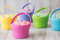 Pastel jelly beans in colored baskets for easter brightly Royalty Free Stock Images