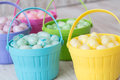 Pastel jelly beans in colored baskets for easter brightly close up Royalty Free Stock Images