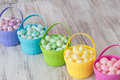 Pastel jelly beans in colored baskets for easter brightly a row Royalty Free Stock Photo