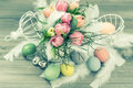 Pastel tulip flowers and easter eggs retro style colored picture selective focus Stock Image